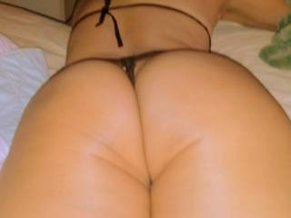 Asian gf in string thong... Mmmm~! Who wants to lick that ass?? ;-)~