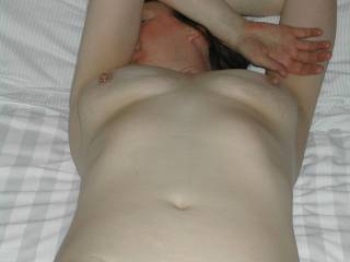 Maybe if I suck on her nice hard nipples her arm will move and reveal her face