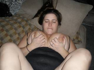 rubbing my titties while he fucks my feet ;-)