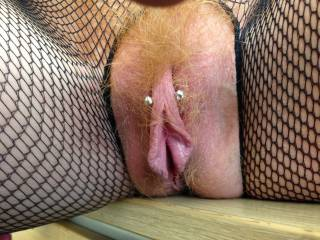 WOW! I love her beautiful pussy lips and her gorgeous pussy hair! That pussy looks delicious! Does the piercing go through her clit? I'll bet she has a nice big clit when it's erect!