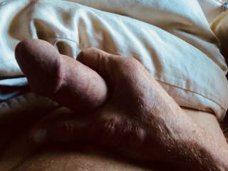 Lying in bed stroking my cock.