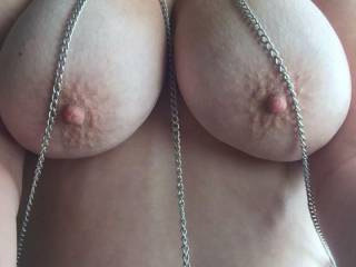 Mmm wrap those chains around her big udders nice and tight and make her soaking wet