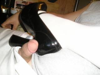Love the heels and I wish that was my cock!