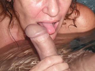 Licking and sucking his lovely smooth thick cut cock in the spa at home.