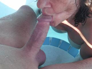 Sucking his lovely smooth shaven cock in the swimming pool at home.