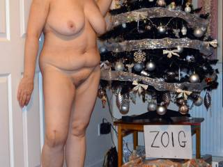 Great pic ! shows off her lovely big tits, belly fat , sexy legs and hairy cunt nicely. Would love to have her sit on my cock under that tree