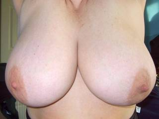 Wow, those are just extraordinary.   Beautifully shaped, massive and topped with nipples just crying out to be sucked on.   Amazing body...