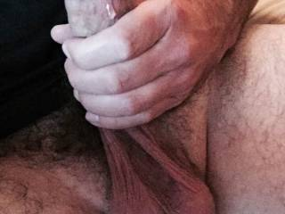 Stroking my cock with precum dripping down the shaft. Cumming soon.