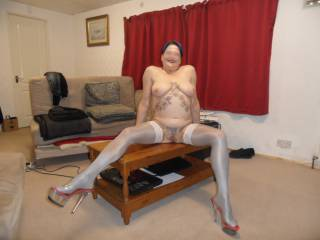 Hi all hubby says these new shiny stockings look great on me, what do you think? dirty comments welcome mature couple