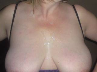 Great pic, awesome tits! The cum drip from the corner of her mouth is hot.