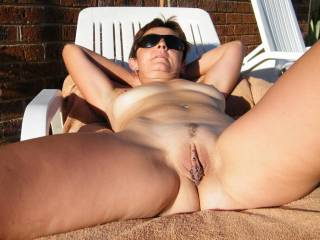 Nice spread! Hope you get someone to come lick and eat you to multiple orgasms after basking out in the sun like this! ;-)