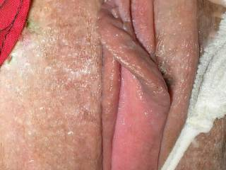 A very sexy pic - such kissable swollen, moist lips. Just the place for a slow licking.