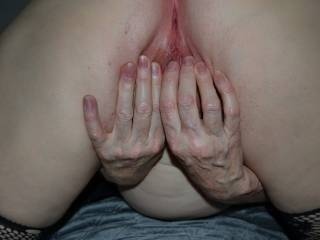 Spreading her pussy lips for a cock. Any takers?