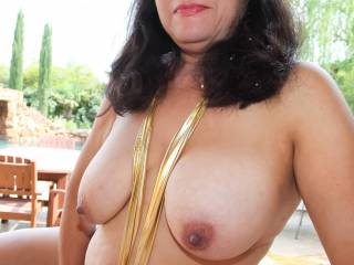 Post backyard blowjob posing on the back porch...nude with cum in my hair and mouth, wondering if any neighbors are watching.
