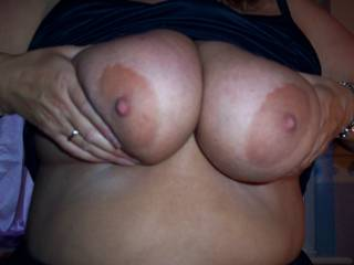 I'd love to suck them...and feel your nipples getting bigger and harder as I hold them between my lips and tease them with my tongue. xxx :-)