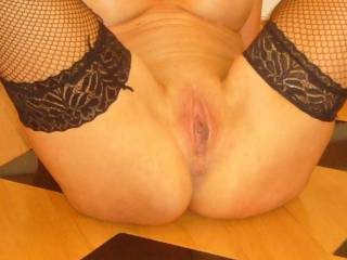 Sat on the dinner table with my stockings and boots on flashing my shaven pussy.....
