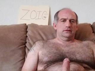 On couch stroking my big, hard dick for you.