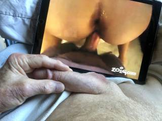 Stroking my cock as I watch.
