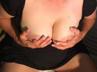 Squeezing her tits on cam