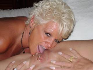 fantastic pic! love you looking at the camera with your tongue pushing into that smooth pierced pussy.  mmmmm love to have been there to see it for real!