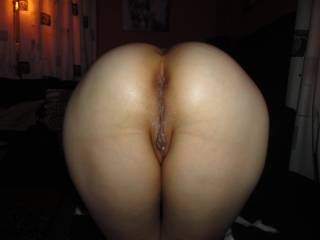 Love to be behind her spanking that ass while I slowly enter her waiting pussy!