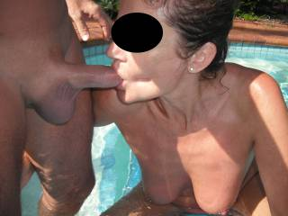 Sucking his lovely smooth thick cock in the swimming pool at home.