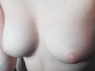 Showing off her sweet little tits
