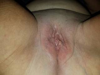 Spread open , she just told me she wanted me to eat her til she cumms. Gotta love it!!