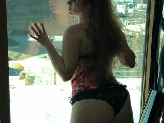 Spice looking out window of Mandalay Bay in Vegas
