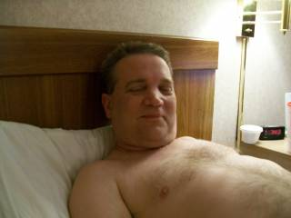 laying in hotel room, face and chest shot