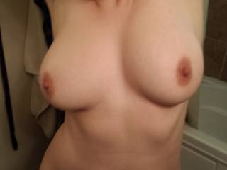 Nice tits you should get them peirced that's a big turn on very sexy pic thanks for letting me ck them out