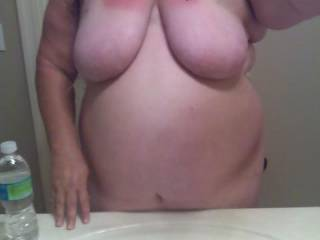 Great pic! Love your heavy tits!! Would enjoy bending you over that sink and pounding your pussy!!!