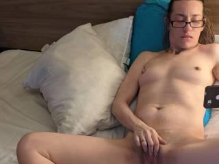 Watching a video and masturbating