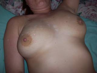 Sometimes Hubby enjoys pulling out of me and blowing his load over my tits