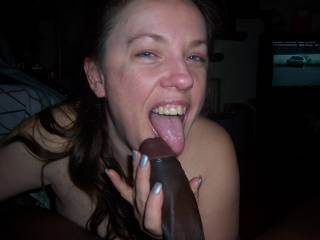 She does havea nice smile, but I'd be smiling like that too if I got to suck and fuck that nice, thick, beautiful, black cock...