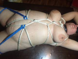Her bbw body looks amazingly sexy wrapped in all those ropes. Bodies like hers turn me on anyway - but in bondage - wowser - i'm turned on.  You clearly know your rope skills. Great work.  Keep posting more of her sexy body in or out of bondage.  Love bbw/big tit bodies oiled up if you want any inspirations.