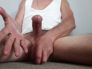 Oozing precum has made my palm moist and sticky