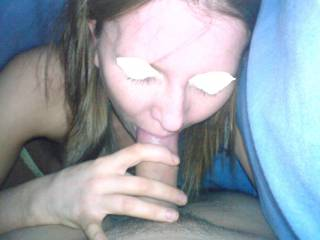 gettin a blowjob under the covers and couldnt resist a quick pic....she\'s a devoted cock sucker and i love that