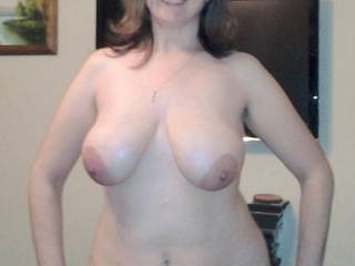 Very sexy picture! Nice hanging tits!! Love them!! My gf also have these big hanging tits!. But a bit more hanging. Please come by and drop a comment on my gf aswell. Both of us likes it ;)