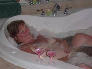 Taking the time to chill and enjoy some champagne and a bubble bath in between being naughty. Do I look mischevious?