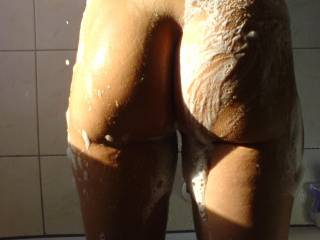 Mmmm, this pic instantly makes me wanna have a private moment of my own in the shower! Oh how good it would feel having my throbbing soaped up cock slowly sliding between your bum & thighs ;-) Hoping you post some pics...