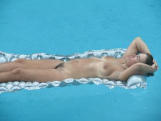 My wife naked in the pool for everyone to see