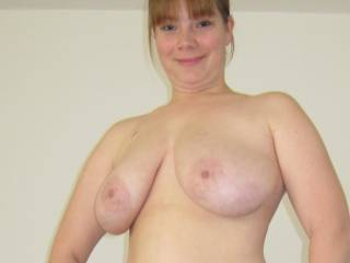 Tits exposed for your enjoyment. She loves cum on her tits.