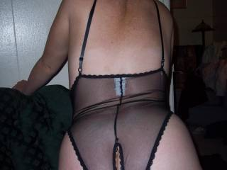 Another very sexy open cotch playsuit.  Lovin it and you.