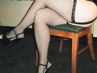 Melissa modeling her long, curvy legs in fishnet stockings and platform heels!