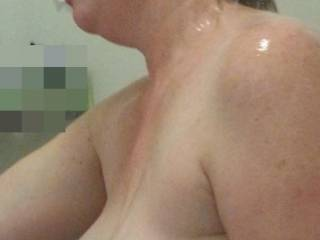 Milk filled tits in the shower