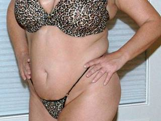Posing in her bra and panties