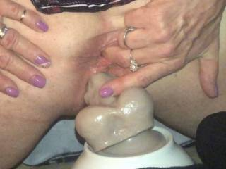 setting on a 12 inch dildo and finger my ass