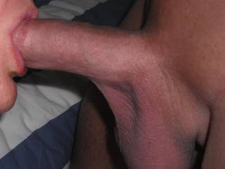 The best way to start the day.  Sucking his lovely smooth thick cock and emptying my hubbies big balls to get my morning vitamin and mineral intake.
