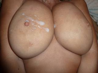 wow, big beautiful tits! love that creamy load all over, very sexy!